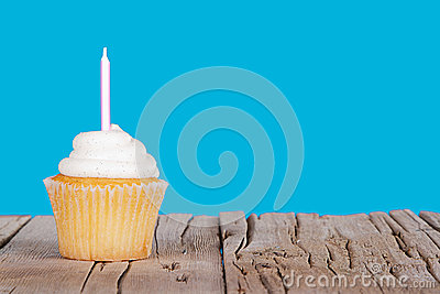 Single cupcake with pink candle