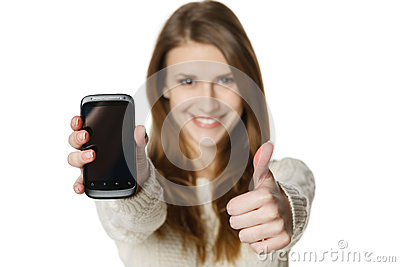 Happy woman showing her mobile phone and gesturing thumb up