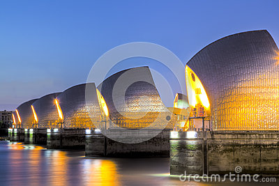 Thames Barrier And Canary Wharf, London UK