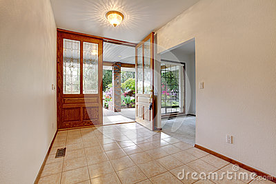 Empty front entrance with open door. Home interior.