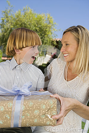 Mother Gifting A Present On Birthday