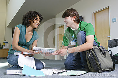 Man Helping Friend To Pick Up Books