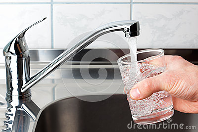 Glass filled with drinking water from kitchen faucet.