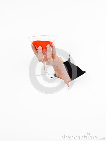 Female hand holding martini glass
