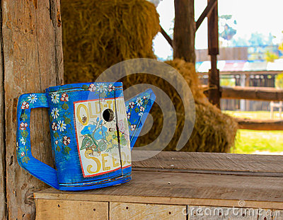 Blue wooden wateringcan