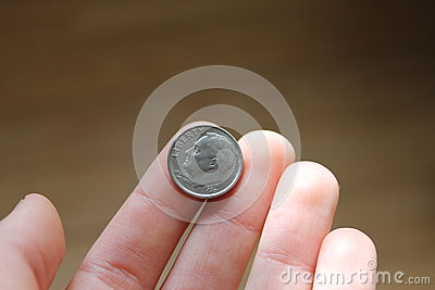 One dime in hand