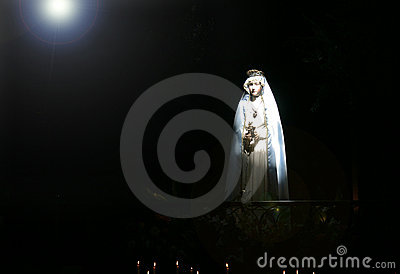Madonna in strong beam of light