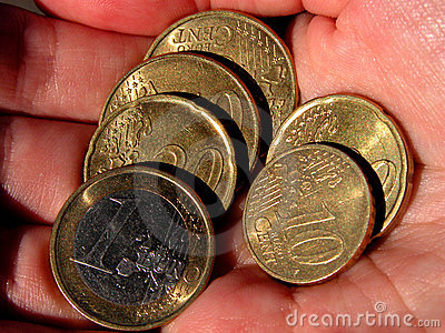 Eurocoins in hand