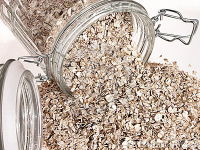 Food: Raw Oats Spilling Out of Glass Jar
