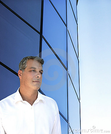 Businessman in front of building