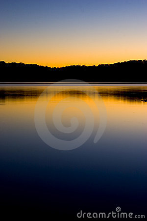 Sunset on lake reflection