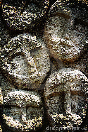 Faces on stone
