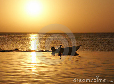 Sunset with man in boat