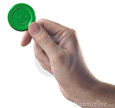 Hand with green button