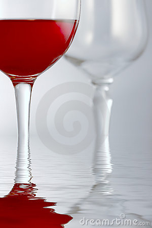Red drink in glass in water