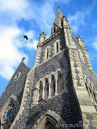 Crow flying over church