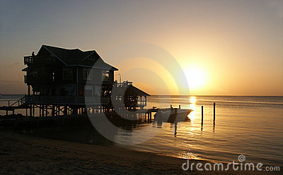 House with sunset on the seashore