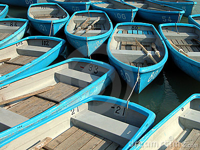 Small blue rowboats