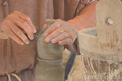 Potter's hands at work