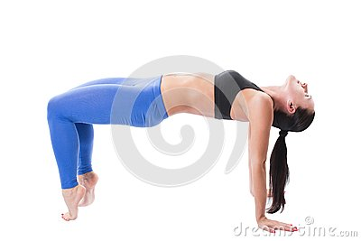 Sexy young yoga woman doing yogic exercise on isolated
