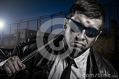 Close up portrait of stylish secret dangerous man with steel baton