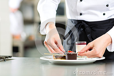 Cook, pastry chef, in hotel or restaurant kitchen