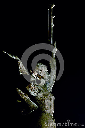Statue of a woman with fanfares