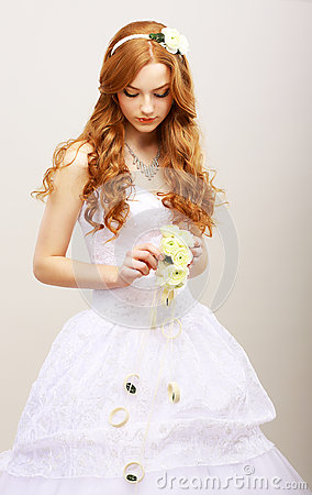 Tenderness & Romance. Red Hair Bride with Fresh Flowers in Reverie. Wedding Style