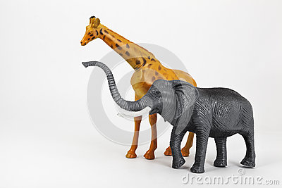 Plastic toy animals giraffe and elephant