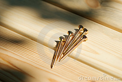 Bunch of screws on wood