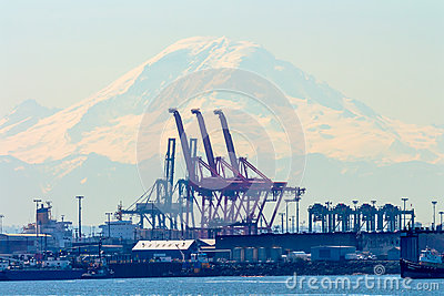 Seattle Port with Red Cranes and Boats with Mt Rainier in the bac