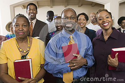 African American People With Bibles In Church