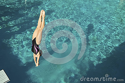 Diver Diving Into Pool