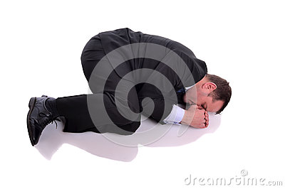 Businessman in fetal position