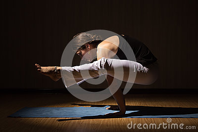 Yoga woman practising her strength and balance