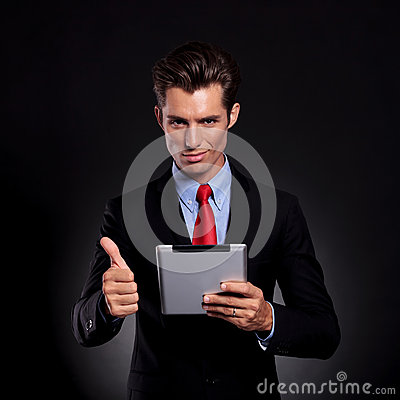 Business man with pad shows ok