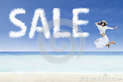 Girl jumping and sale cloud on white sand beach