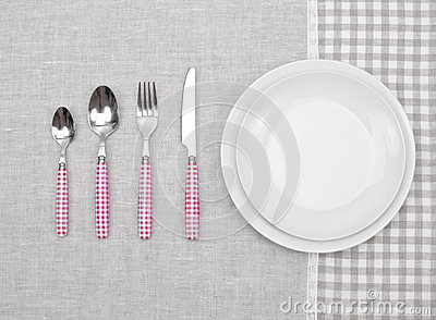 Plate with fork, spoon and knife