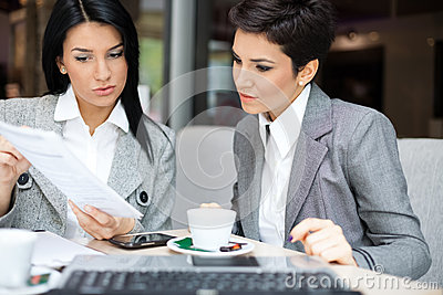 stock image of business women in meeting