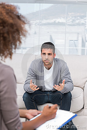 Man speaking to a therapist