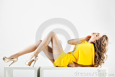 Beautiful woman with long legs dressed elegant posing in the studio - full body