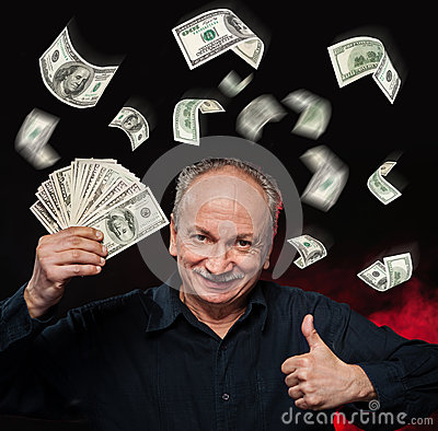 Rain of dollar bills. Lucky old man holding with pleasure group of ...
