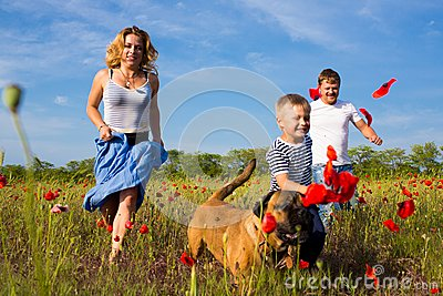 Family on the poppy meadow