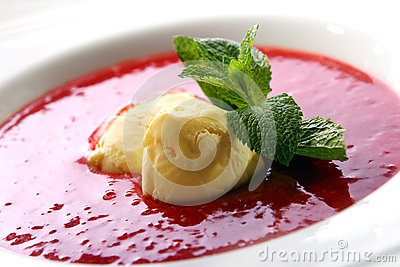Strawberry soup with natural ice cream and mint