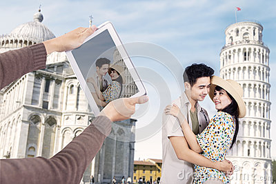 Asian couple at Pisa Tower Italy