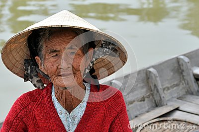 Very old native woman from Vietnam with the traditional hat