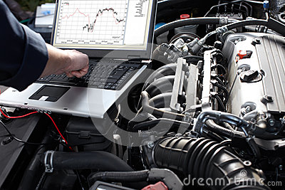 Car mechanic working in auto repair service.