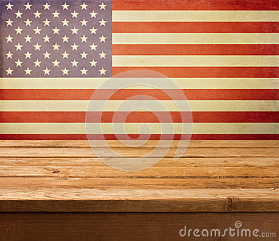 Empty wooden deck table over USA flag background. Independence day, 4th of July background.