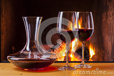 Red wine at fireplace with decanter
