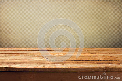 Vintage background with wooden deck table over grunge wallpaper with squares